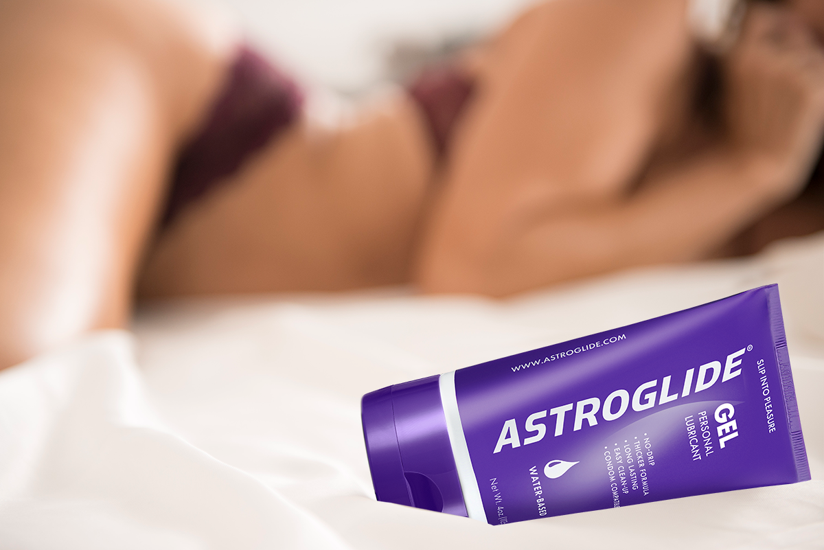 women in bed with astroglide lube