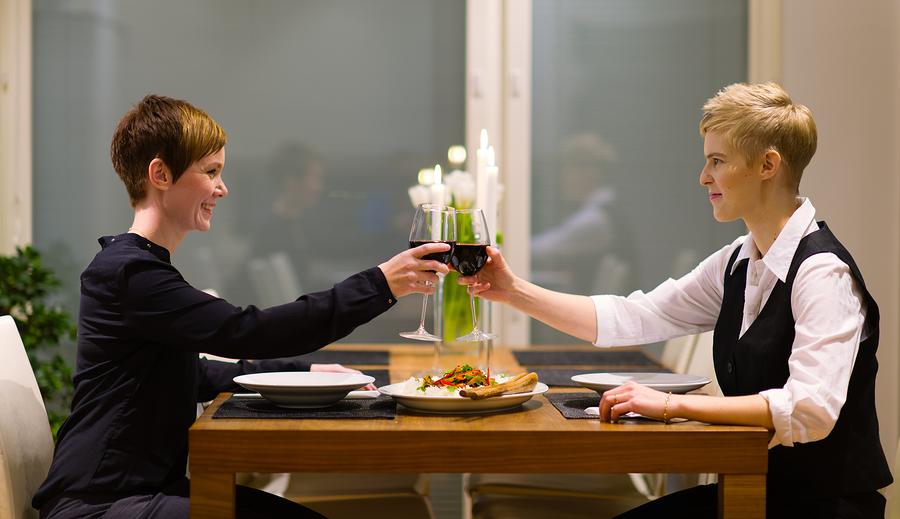 lesbian couple enjoying romantic dinner