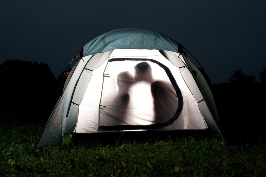 couple kissing in a tent