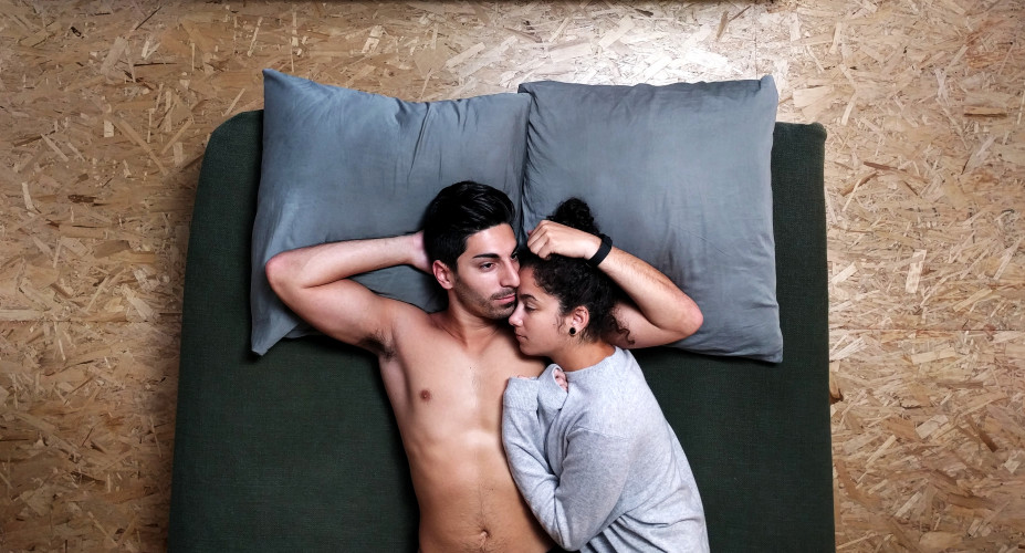 couple watching porn in bed