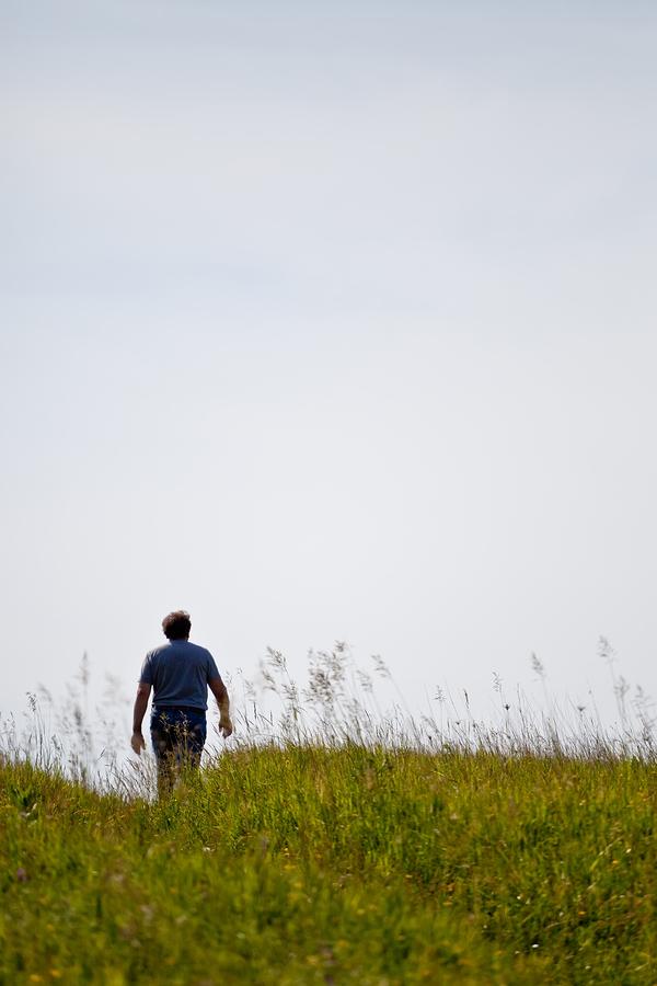 man walking on a trail solo